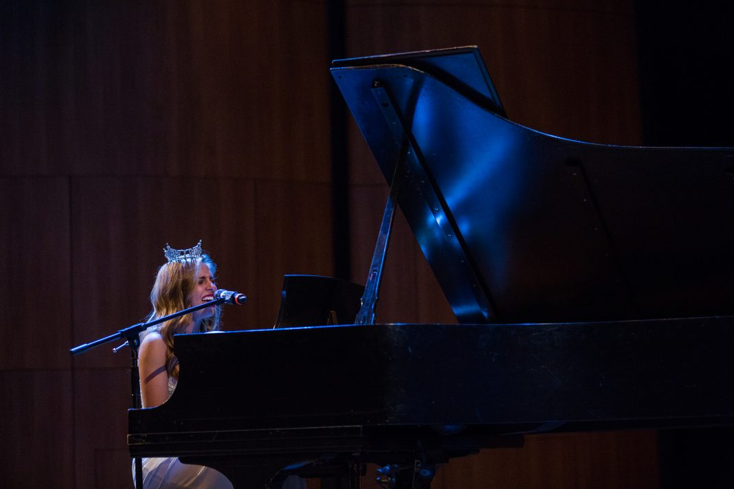 Kelsey Stone sings and plays a grand piano at the Miss Arkansas competition