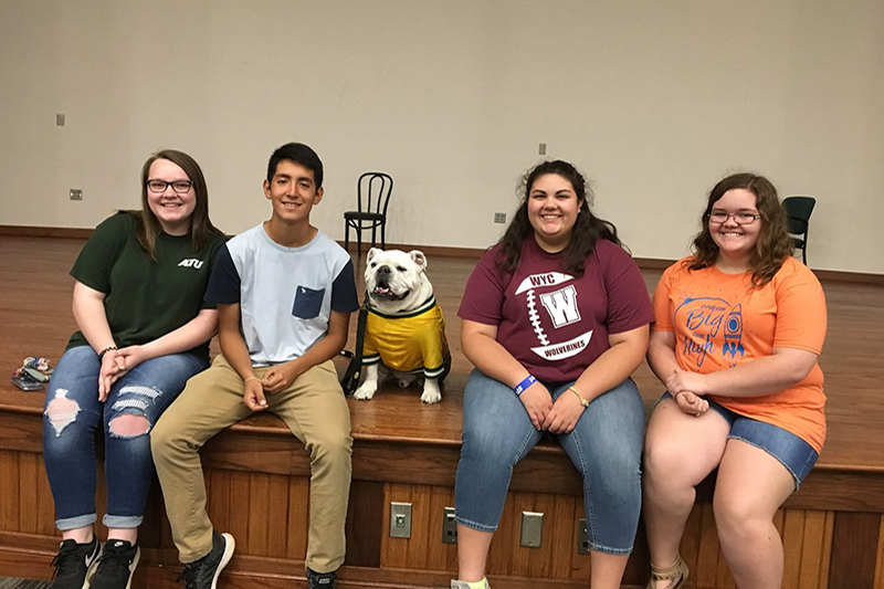 Upward Bound students pose with Jerry the Bulldog