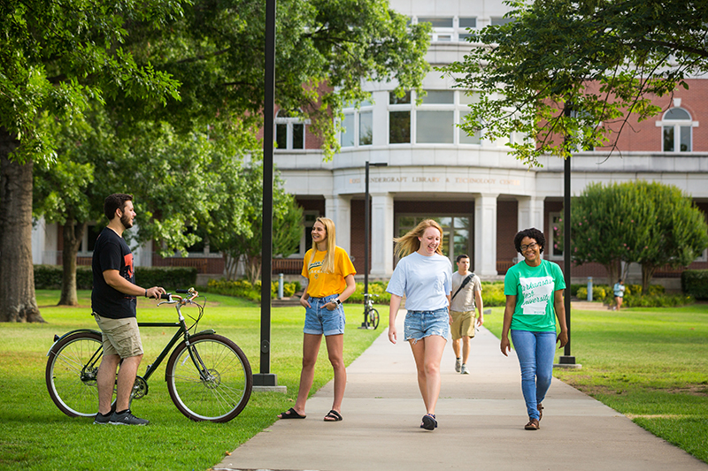 ATU students walk across campus on a sunny day