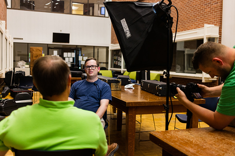 Sam Strasner and Ryan Taylor are seen interviewing Jacob Lehman about his band camp experience