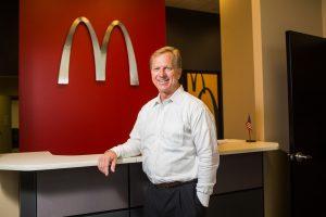 ATU Alumn Kevin Hern greets the camera at his McDonalds franchise headquarters