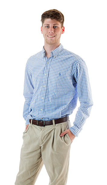 ATU student Kyler Keddie wears a plaid button up shirt and khaki pants