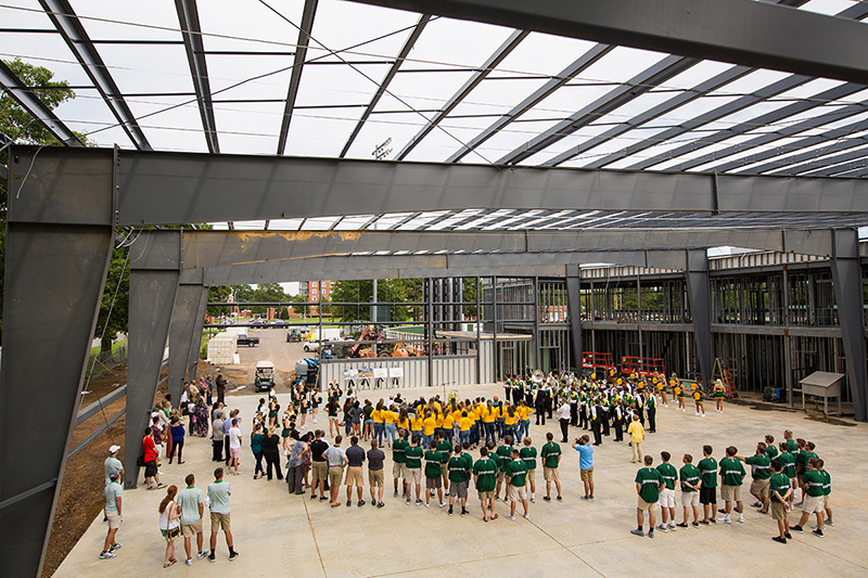 The steel framing of the new building can be seen during the ceremony