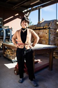 Artist Manami Ishimura smiles brightly in the Norman Hall sculpture studio
