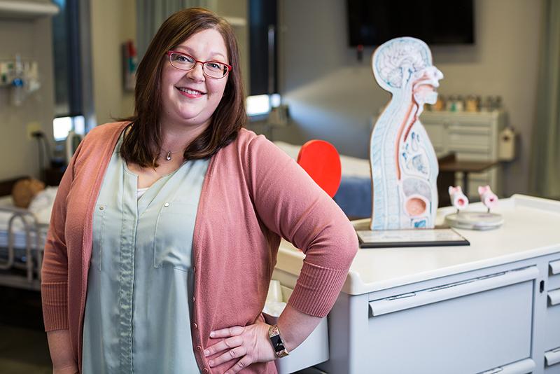 Lesley Krohn stands in an ATU-Ozark classroom