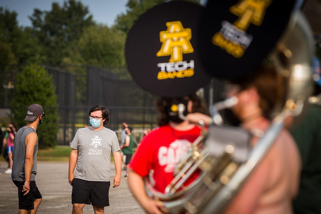 Michael Barker on the ABD practice field, speaking with drum major Issac Deaver during practice.
