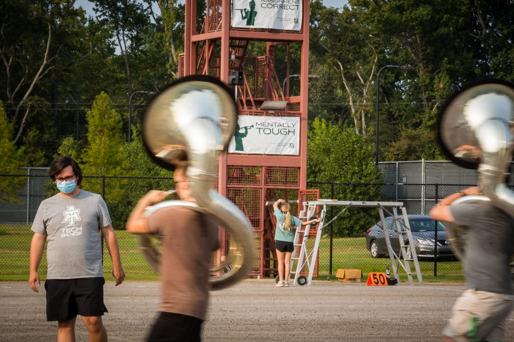 Michael Barker watching as the sousaphone line marches by quickly.