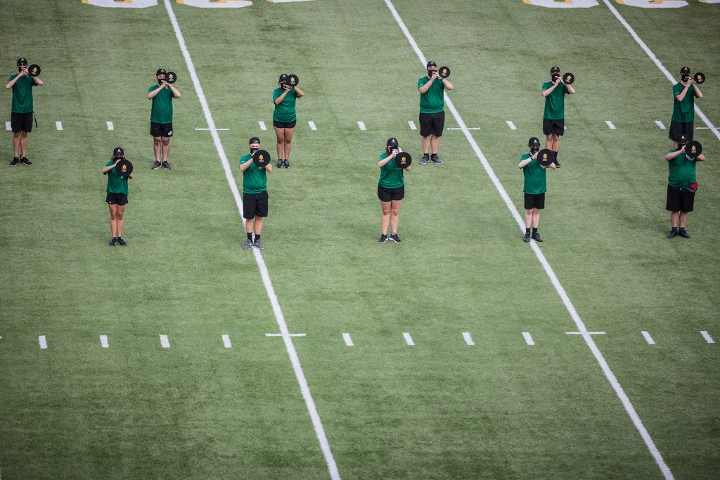 The trombone section from above, practicing their drill.
