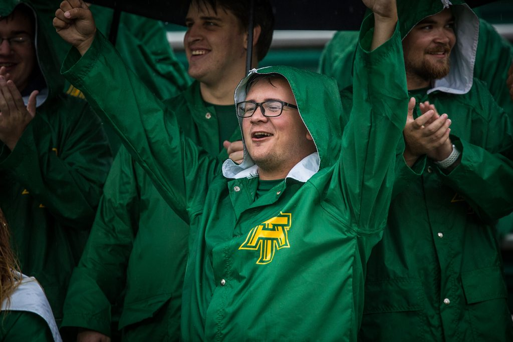 Barker, cheering on the Wonder Boys during a rainy football game in 2018.