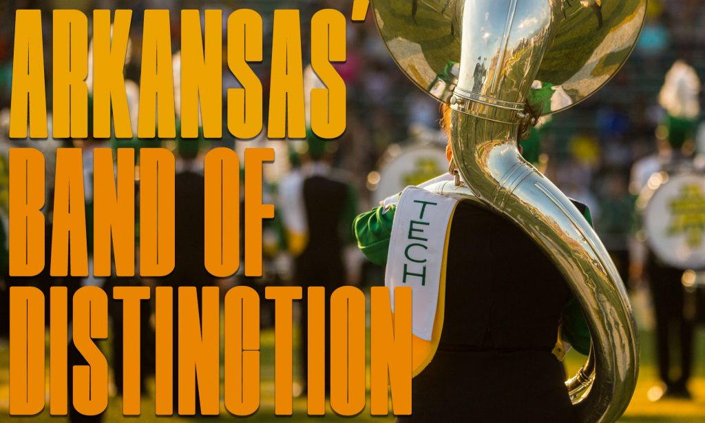 """""""Arkansas' Band of Distinction"""" graphic. The back of a sousaphone player during the opening number of a football game."""